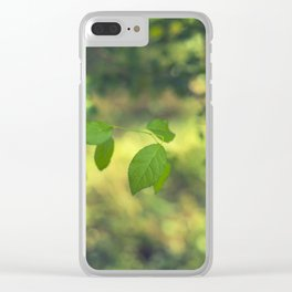 Green leaves and swirly bokeh effect Clear iPhone Case