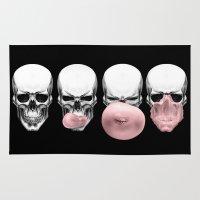 skulls Area & Throw Rugs featuring Skulls chewing bubblegum by Piotr Burdan