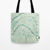 paris map Tote Bags featuring Paris Map Blue Vintage by City Art Posters