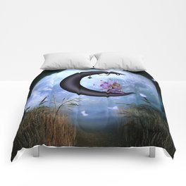 Beautiful fairy sitting on the moon Comforters