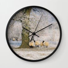 Sheep gathered under a tree covered in a thick hoar frost. Norfolk, UK. Wall Clock