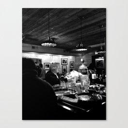 Reading at the Bar Canvas Print