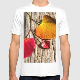 Red Bud Leaves on Rustic Wood Photograph T-shirt
