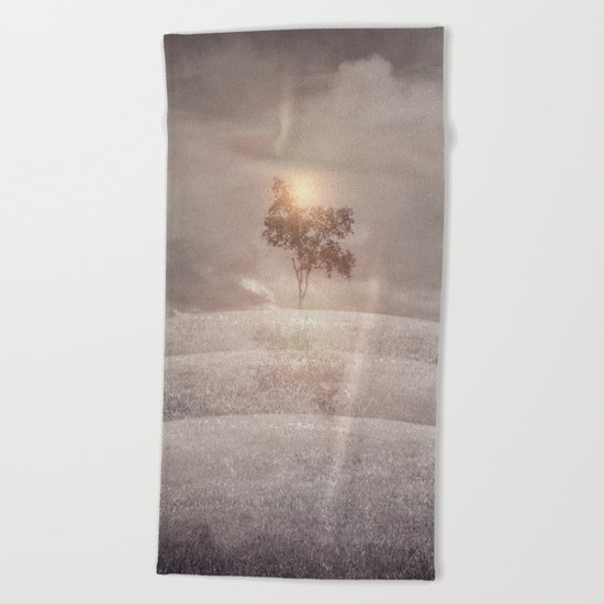 The lone tree Beach Towel