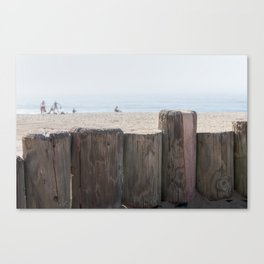 Family playing on the sand of Laguna Beach, CA Canvas Print