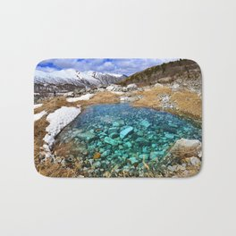 Mountain landscape with icy summit and small lake in Georgia Bath Mat