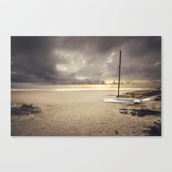 Dramatic sunrise on the beach Canvas Print