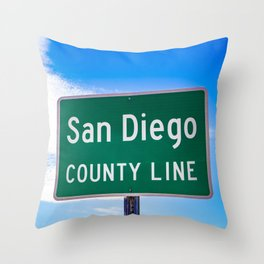 Closeup of the San Diego County Line Sign against a Blue Sky in the Anza Borrego Desert State Park Throw Pillow