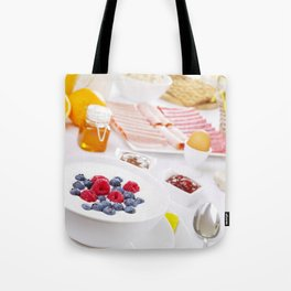 II - Table full with continental breakfast items, brightly lit Tote Bag