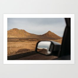View of red mountains through a car window in north Iceland Art Print