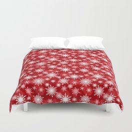 Christmas pattern. Lacy snowflakes on a red background. Duvet Cover