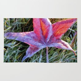 Fallen Autumn Red Leaf in the Grass during Morning Frost Rug