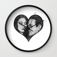 selena gomez Wall Clocks featuring Morticia and Gomez by Jake Anthony
