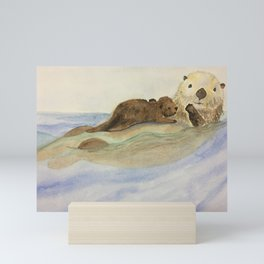 Mama and baby otters Mini Art Print