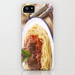 Spaghetti with meatballs and parmesan cheese on a rustic table iPhone Case