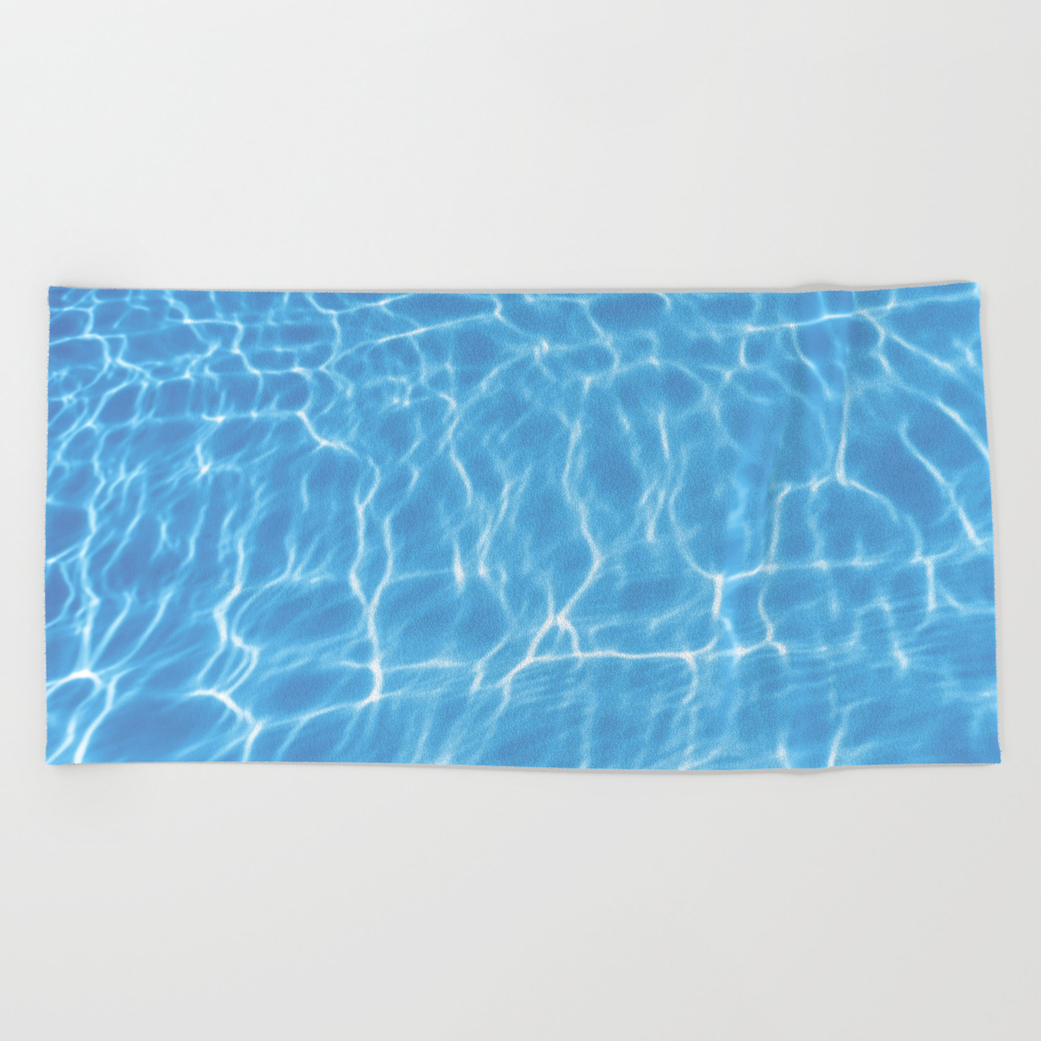 Blue ripped water in swimming pool background Beach Towel