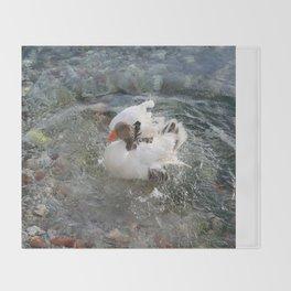 Duck Splashing Water Creating Ripples on Riverbank Throw Blanket