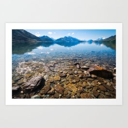 Snow-capped mountains view in summer from the rocky shore of lake Wakatipu. Art Print