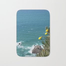 the earth ends and sea beggins Bath Mat