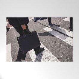 Group of businessmen and women walk along crosswalk in Shinjuku, Tokyo, Japan Welcome Mat