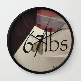 67 lbs. Wall Clock