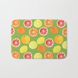 Grapefruit Lemon Orange on Greenery Background Bath Mat