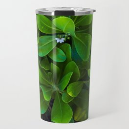 Green leaf coastal plant with white flowers in bloom.  Close up vertical image. Travel Mug