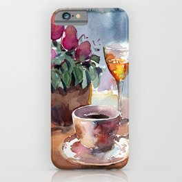 Romantic meeting. Round table of a street cafe with a cup of coffee, liqueur and flowers in a pot  iPhone Case