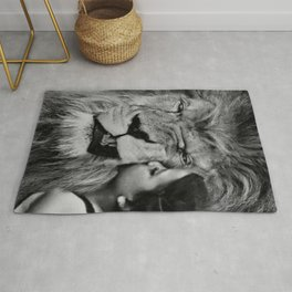 Grouchy Lion being kissed by brunette girl black and white photography Rug