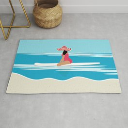 Solo surfing woman Rug