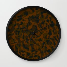 Spotted brown blots on a dark military. Wall Clock
