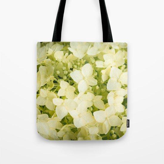 The flowers of white hydrangeas. Tote Bag