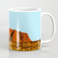 polygon Mugs featuring uluru polygon by Matthias Hennig