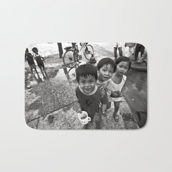 Vietnamese Children with a goldfish  Bath Mat