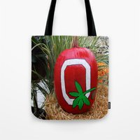 ohio state Tote Bags featuring Ohio State Pumpkin by Photography by Michiale