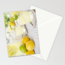 Refreshing lemonade on a rustic outdoor table in bright light Stationery Cards