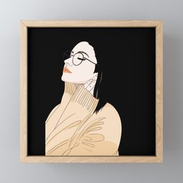 Young woman with glasses feels good and relaxed Framed Mini Art Print