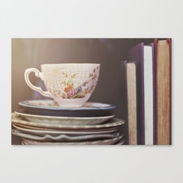 Vintage teacup and old books Canvas Print