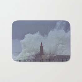 Stormy wave over old lighthouse and pier of Viavelez Bath Mat