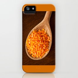 Healthy food red lentils on wooden spoon iPhone Case
