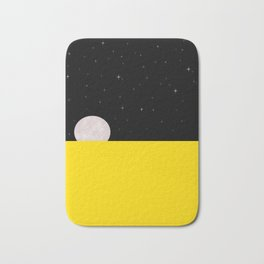 Black night with stars, moon, and yellow sea Bath Mat