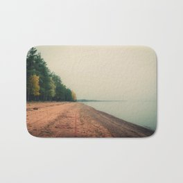Beautiful landscape: the ocean and the shore where trees grow Bath Mat