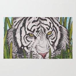 White tiger in wild grass Rug