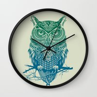 city Wall Clocks featuring Warrior Owl by Rachel Caldwell
