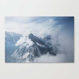 Misty mountain tops in the Alps Canvas Print