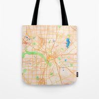dallas Tote Bags featuring Dallas, Texas by Emily Day