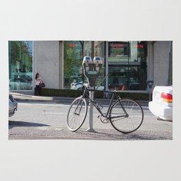 Bike locked to parking meter Rug