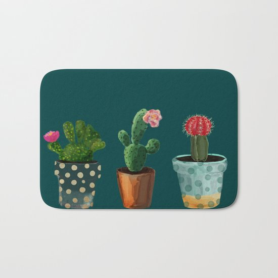 Three Cacti With Flowers On Green Background Bath Mat