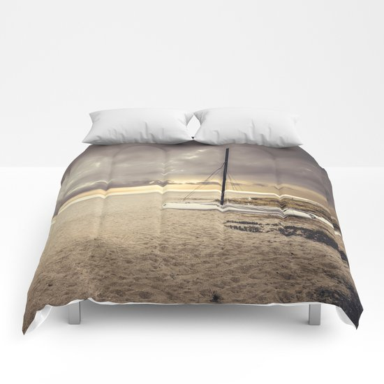 Dramatic sunrise on the beach Comforters
