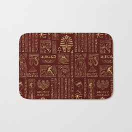 Egyptian hieroglyphs and symbols gold on red leather Bath Mat